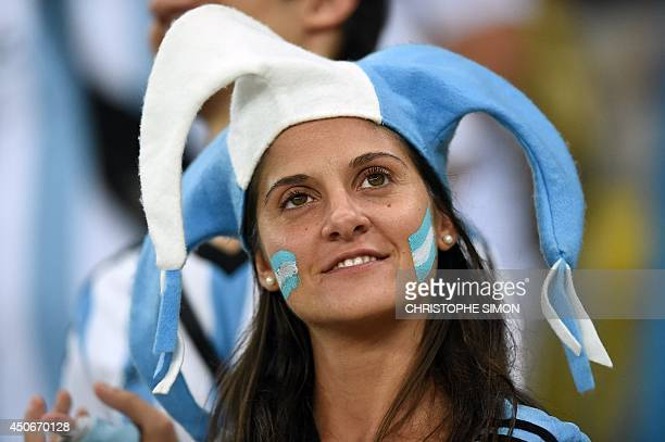 An Argentina fan waits for the start of the Group F football match between Argentina and BosniaHercegovina at the Maracana Stadium in Rio De Janeiro...