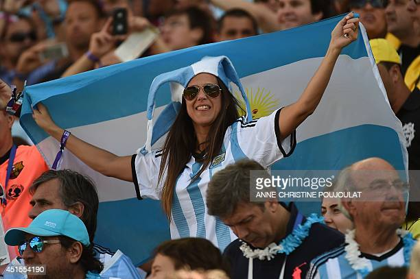 An Argentina fan waves her national flag during the Round of 16 football match between Argentina and Switzerland at the Corinthians Arena in Sao...