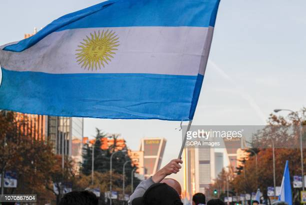 An Argentina Flag seen waved by supporters in Paseo de la Castellana in Madrid The Copa Libertadores Final match between River Plate and Boca Juniors...