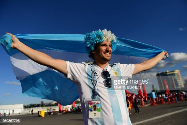 An Argentina's fan displays a national flag as he waits outside the stadium before the Russia 2018 World Cup Group D football match between Argentina...