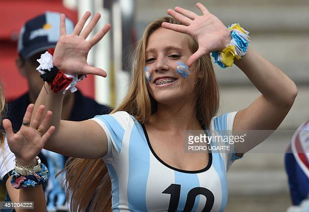 An Argentina's fan poses before the Group F football match between Nigeria and Argentina at the BeiraRio Stadium in Porto Alegre during the 2014 FIFA...