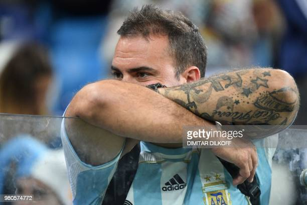 An Argentina's fan reacts after being defeated by Croatia at the end of the Russia 2018 World Cup Group D football match between Argentina and...