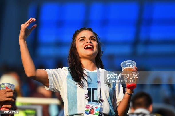 An Argentina's fan shouts and gestures as she waits in the grandstand before the Russia 2018 World Cup Group D football match between Argentina and...