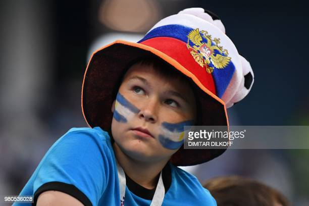 An Argentina's fan sporting a Croatian hat looks on before the Russia 2018 World Cup Group D football match between Argentina and Croatia at the...