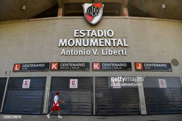 An Argentina's River Plate supporter walks outside the Monumental stadium in Buenos Aires on November 8 2018 Millions of football mad fans in...
