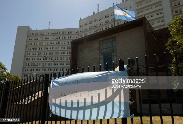 An Argentine flag with a message giving strength to the submarine crew are seen outside Argentine Navy headquarters in Buenos Aires where Argentine...