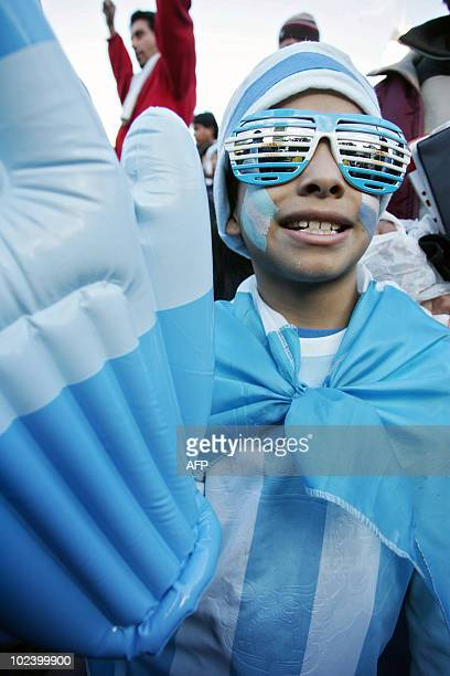 An Argentinian fan watches the FIFA World Cup South Africa 2010 football match between Argentina and Greece on an outdoor screen in Buenos Aires...