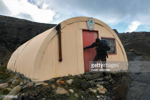 An Argentinian guide leaves a glacial research station quonset hut near the Upsala glacier, part of the Southern Patagonian Ice Field, during a...