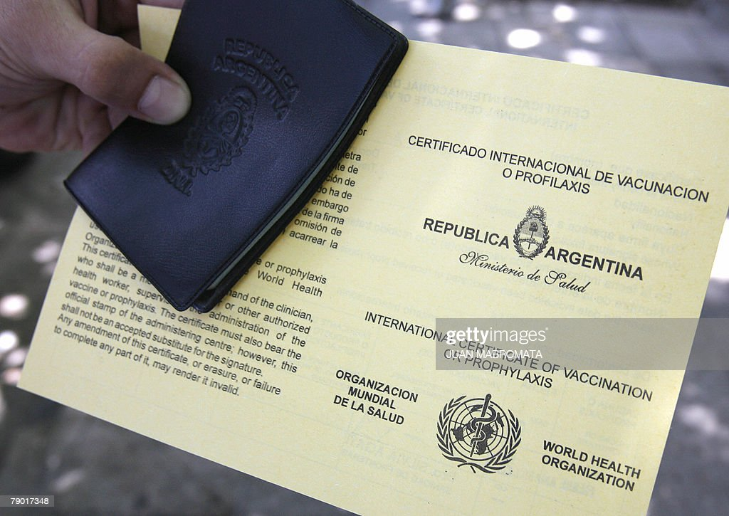 An Argentinian national holds his ID car : News Photo