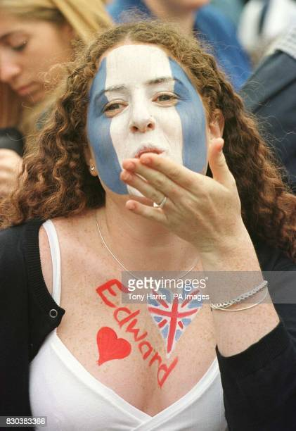 An Argentinian wellwisher blows a kiss from amongst the crowds lining the streets of Windsor on the day that Prince Edward the youngest son of...