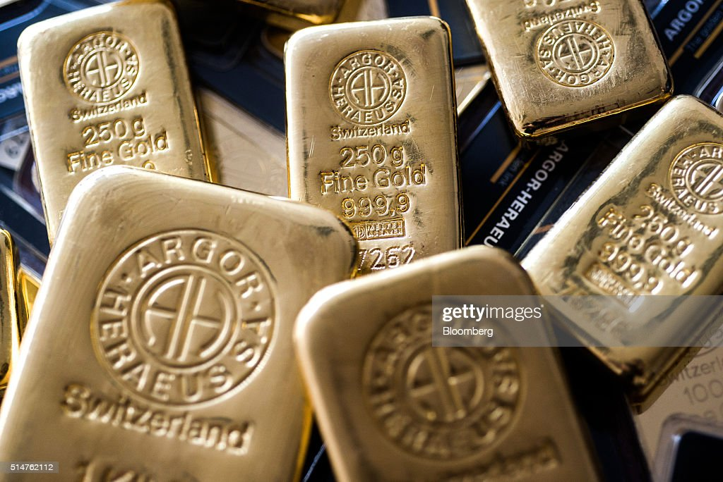 An Argor-Heraeus SA branded two hundred and fifty gram gold bar, center, sits in this arranged photograph at Solar Capital Gold Zrt. in Budapest, Hungary, on Thursday, March 10, 2016. Gold advanced to the highest level in a year after the European Central Bank indicated it wouldn't cut interest rates further, boosting the euro and making dollar-denominated bullion less expensive for investors. Photographer: Akos Stiller/Bloomberg via Getty Images