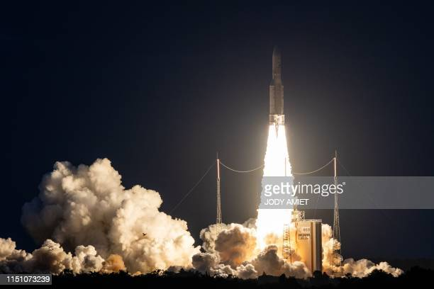 TOPSHOT An Ariane 5 lifts off from its launchpad in Kourou at the European Space Center in French Guiana on June 20 2019 It's payload is two...