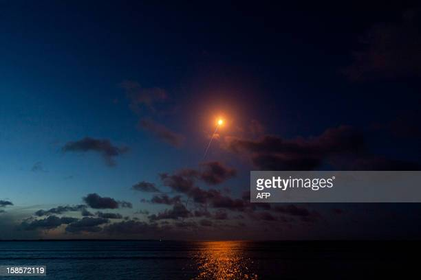 An Ariane 5 rocket carrying two satellites Skynet 5D and Mexsat Bicentenario is pictured from Cayenne after blasting off on December 19 2012 from the...