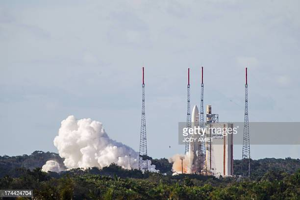 An Ariane 5 rocket takes off at the French and European spaceport Guiana Space Centre near Kourou in French Guiana on July 25 2013 The rocket carried...