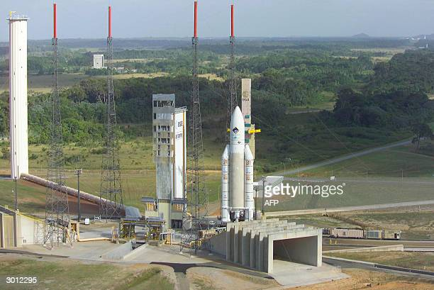 An Ariane 5G atop its mobile launch platform leaves the 90mtall Final Assembly Building where its was mated with its payloads for a 28km transfer to...