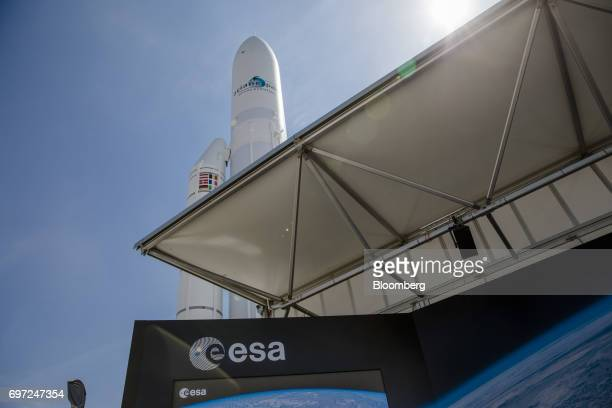 An Arianespace SA rocket stands beyond the European Space Agency exhibition stand ahead of the 53rd International Paris Air Show at Le Bourget in...