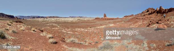 an arid landscape on the side of highway 95 overlooking the lake powell area in the distance - fitopardo stock pictures, royalty-free photos & images