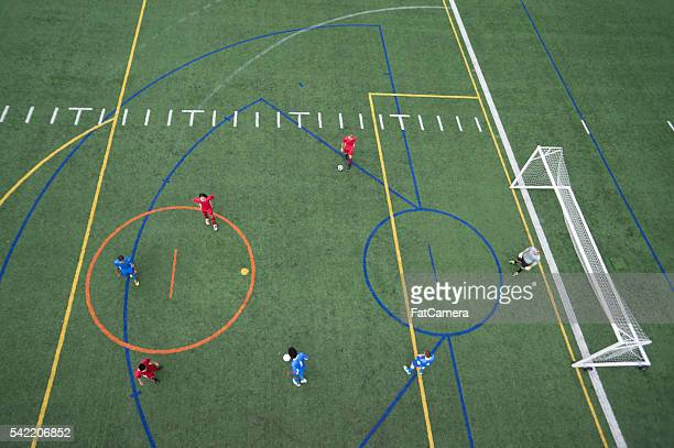 An ariel drone view looking down at a soccer field