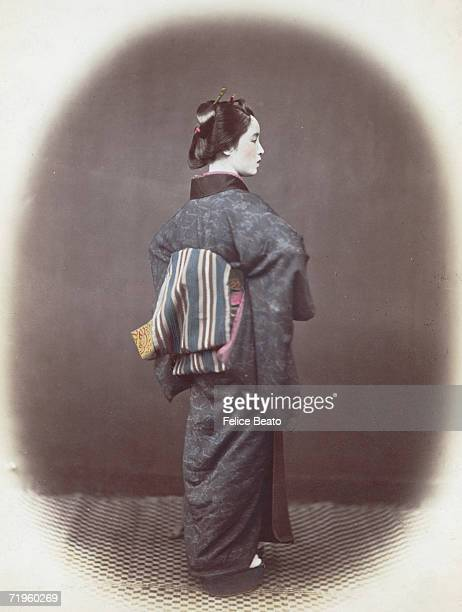 An aristocratic young Japanese lady with an obi or sash tied at the back of her kimono circa 1865