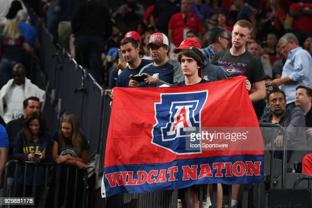 An Arizona fan holds up a Wildcat Nation flag during the Quarterfinal game of the mens Pac12 Tournament between the Colorado Buffaloes and the...