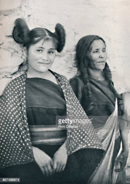An Arizona Hopi girl and her mother 1912 The girl's hairstyle identifies her as being unmarried From The Living Races of Mankind Vol II [Hutchinson...
