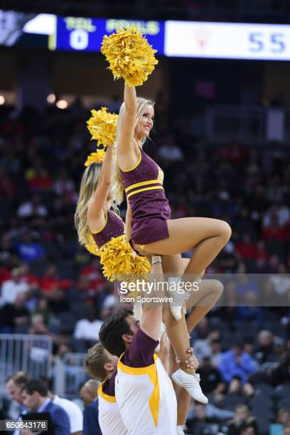 An Arizona State Cheerleader is raised up in the air during the quarterfinal game of the Pac12 Tournament between the Arizona State Sun Devils and...