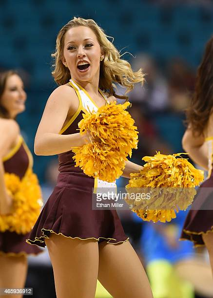 An Arizona State Sun Devils cheerleader performs during a firstround game of the Pac12 Basketball Tournament against the USC Trojans at the MGM Grand...