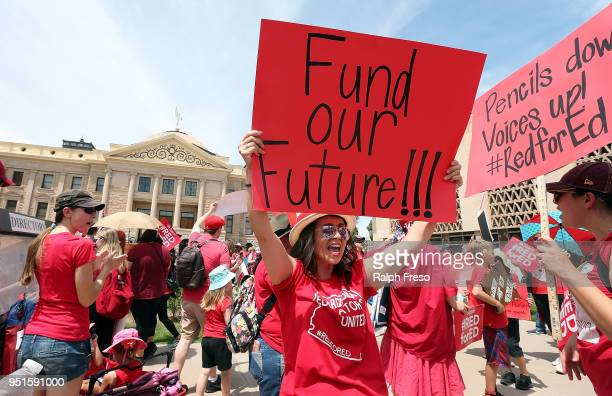 An Arizona teacher holds up a sign in front of the State Capitol during a #REDforED rally on April 26 2018 in Phoenix Arizona Teachers statewide...