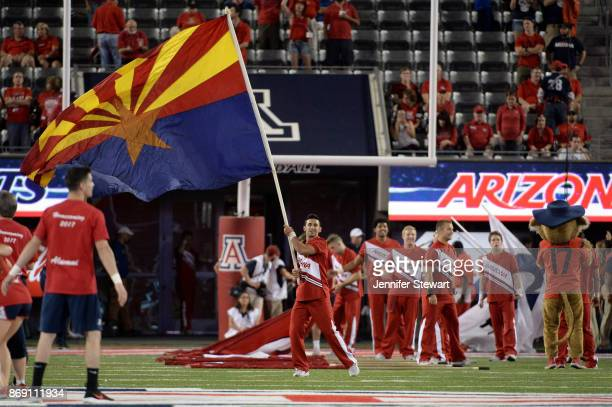 An Arizona Wildcats cheerleader waves the Arizona flag prior game between the Washington State Cougars and Arizona Wildcats at Arizona Stadium on...