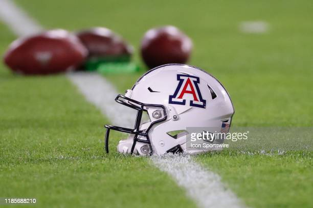 An Arizona Wildcats helmet on the field before the college football game between the Arizona Wildcats and the Arizona State Sun Devils on November...