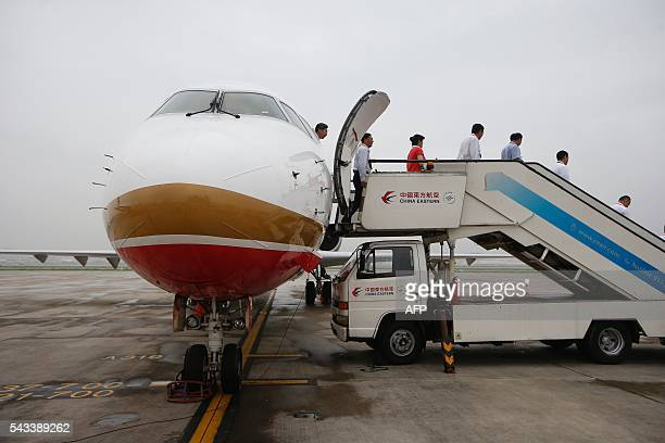 An ARJ21700 China's first domestically produced regional jet arrives at Shanghai Hongqiao Airport after making its first flight from Chengdu to...