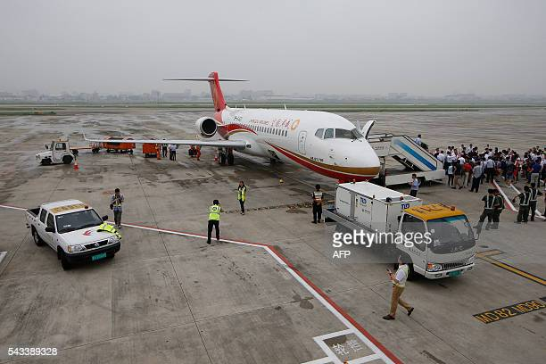 An ARJ21700 China's first domestically produced regional jet arrives at Shanghai Hongqiao Airport after making its first fight from Chengdu to...
