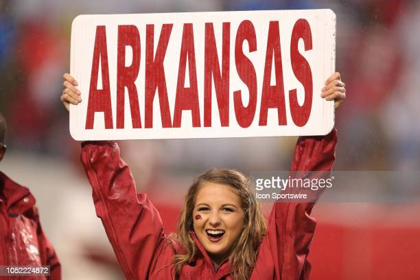 An Arkansas cheerleader entertains the crown before the game between the Arkansas Razorbacks and the Ole Miss Rebels on October 13 at War Memorial...