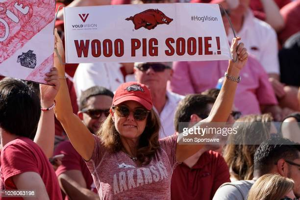 An Arkansas fan holding up a Wooo Pig Sooie sign during the Arkansas Razorbacks 55-20 win over the Eastern Illinois Panthers at Donald W. Reynolds...