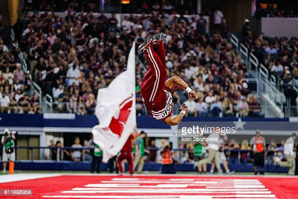 An Arkansas Razorbacks cheerleader does a twist after a score during the Southwest Classic between the Arkansas Razorbacks and the Texas A&M Aggies...