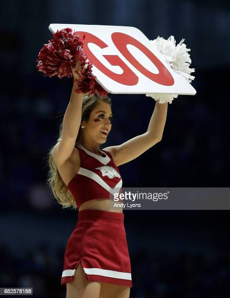 An Arkansas Razorbacks cheerleader performs against the Kentucky Wildcats during the championship game at the 2017 Men's SEC Basketball Tournament at...