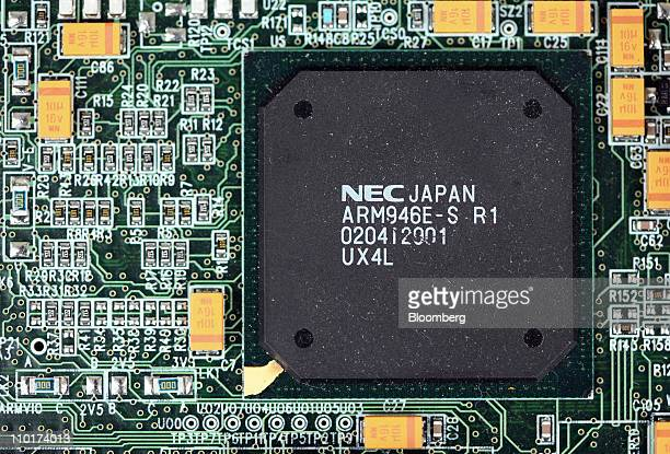 An ARM designed microprocessor chip made by NEC Corp sits on display at the ARM Holdings Plc headquarters in Cambridge UK on Wednesday March 16 2011...