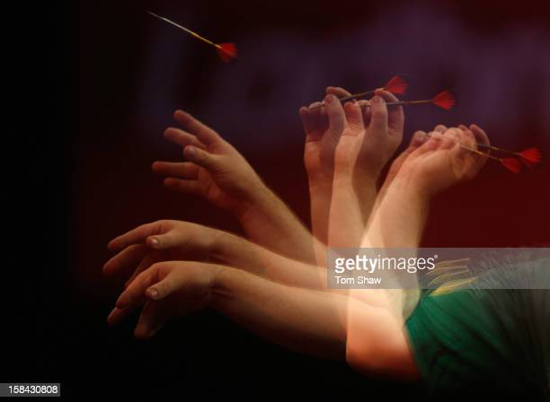 An arm throws a dart during day 3 of the 2013 Ladbrokescom World Darts Championship at Alexandra Palace on December 16 2012 in London England