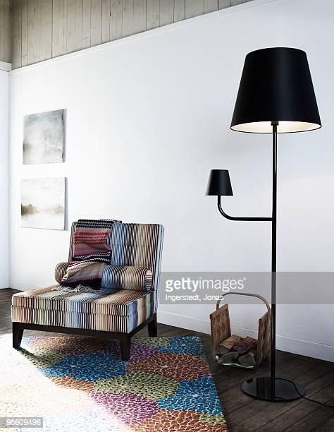 An armchair and a black standard lamp, Sweden.