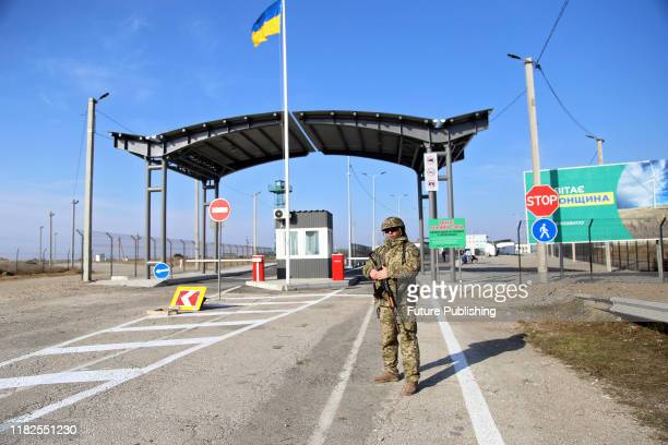 An armed border guard is on duty at the Chonhar checkpoint situated on the administrative border between Kherson Region and occupied Crimea that has...