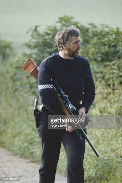 An armed British police officer searching fields during the manhunt for fugitive triple murderer Barry Prudom Malton North Yorkshire June 28 1982...