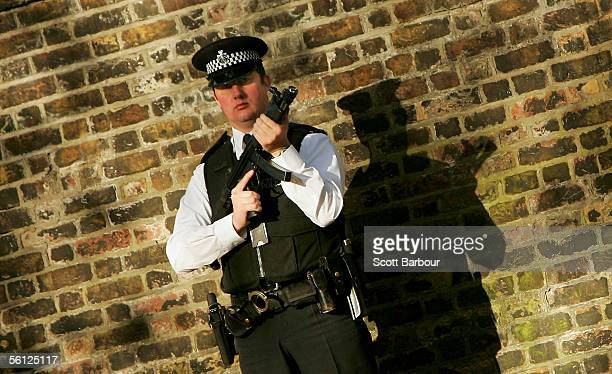 An armed British police officer stands guard outside St. James Palace on November 9, 2005 in London, England. Britain's Prime Minister Tony Blair is...