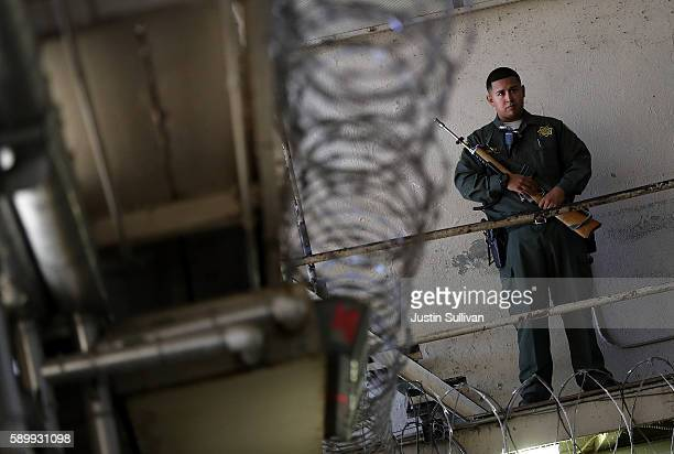 An armed California Department of Corrections and Rehabilitation officer stands guard at San Quentin State Prison's death row on August 15 2016 in...