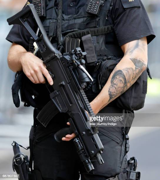An armed City of London Police Officer on duty outside St Paul's Cathedral during a service to mark the one hundredth anniversary of The Order of The...