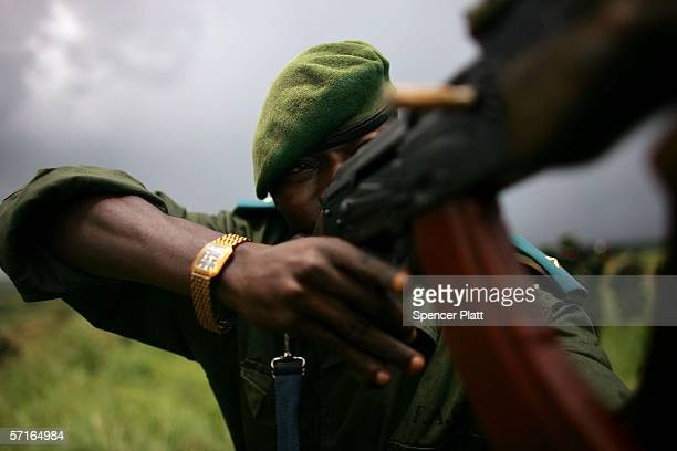 An armed FARDC soldier a member of the national army of the Democratic Republic of Congo participates in training exercises March 23 2006 in Bunia...