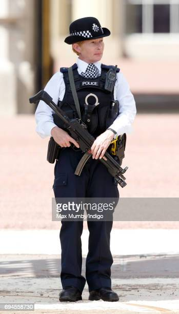 An armed female police officer on duty outside Buckingham Palace during The Colonel's Review on June 10 2017 in London England The Colonel's Review...