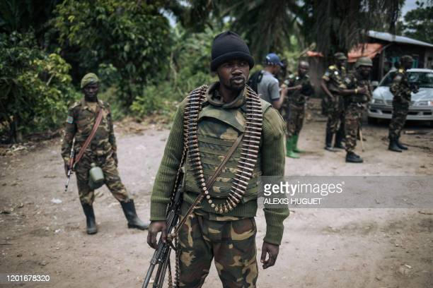 An Armed Forces of the Democratic Republic of Congo soldier takes part in a foot patrol in the village of Manzalaho near Beni on February 18...