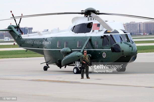 An armed guard stands at Marine One as it sits on the tarmac at Chicago's O'Hare International Airport in Chicago Illinois on OCTOBER 25 2012
