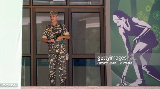 An armed guard stands at the entrance to the Dhyan Chand National Stadium the venue for hockey during the 2010 Commonwealth Games in New Delhi India