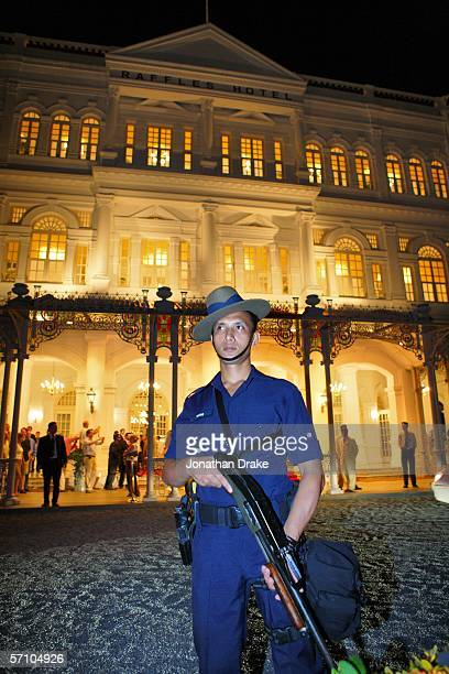 An armed Gurkha soldier with the Singapore Police Force stands guard outside Raffles Hotel after Her Majesty Queen Elizabeth II arrived there in...